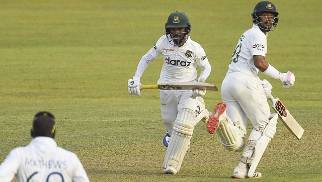 Bangladesh's Najmul Hossain Shanto (right) and teammate Mominul Haque (captain). AFP