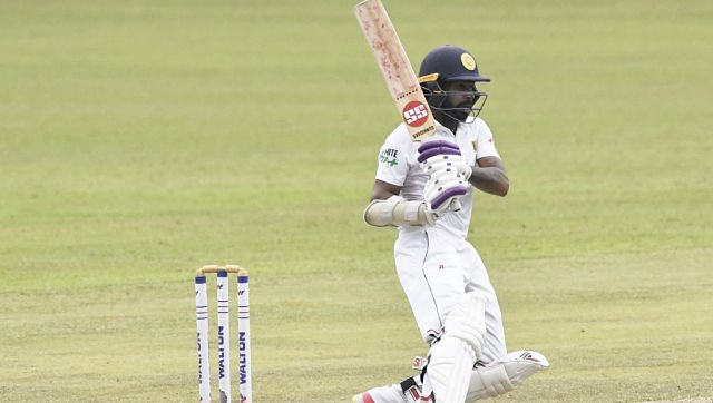 Sri Lanka's Niroshan Dickwella watches the ball after playing a shot during the second day of the second and final Test between Sri Lanka and Bangladesh at the Pallekele International Cricket Stadium. AFP