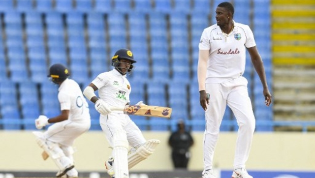 Pathum Nissanka (L) of Sri Lanka get runs off Jason Holder (R) of West Indies during Day 3 of the second Test between West Indies and Sri Lanka. AFP