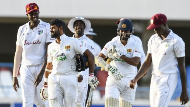 Lahiru Thirimanne (2L) and Dinesh Chandimal (2R) of Sri Lanka laugh with Jason Holder (L) and Hayden Walsh Jr. (C) of West Indies while walking off the field at the end of Day 4 of the second Test between West Indies and Sri Lanka. AFP