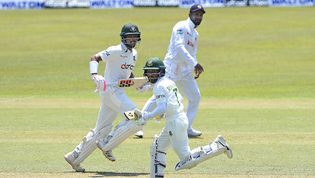 Bangladeshi batsmen Mominul Haque and Najmul Hossain run between the wickets during the second day of the first Test against Sri Lanka. AP
