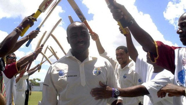Brian Lara's record-breaking innings is celebrated by his teammates. AFP