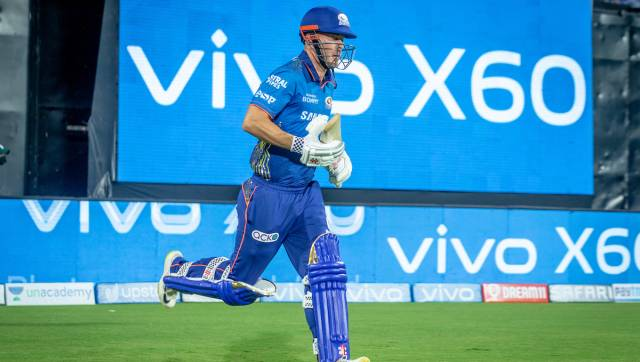 Chris Lynn of Mumbai Indians and Rohit Sharma captain of Mumbai Indians opening batsman for the Mumbai Indians during match 1 of the Vivo Indian Premier League 2021 between Mumbai Indians and the Royal Challengers Bangalore held at the M. A. Chidambaram Stadium, Chennai on the 9th April 2021. Photo by Sandeep Shetty / Sportzpics for IPL