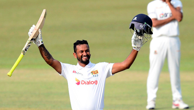 Sri Lanka captain Dimuth Karunaratne celebrates after bringing up his maiden double hundred on Day 4 of the first Test against Bangladesh at Pallekele. AP