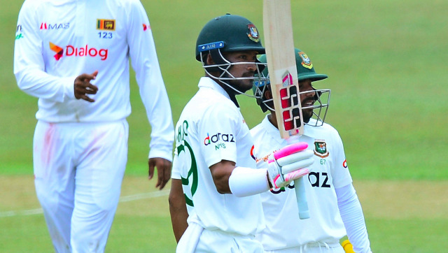 Najmul Hossain Shanto raises his bat after reaching 150 on Day 2 of the first Test against Sri Lanka at Pallekele. AP