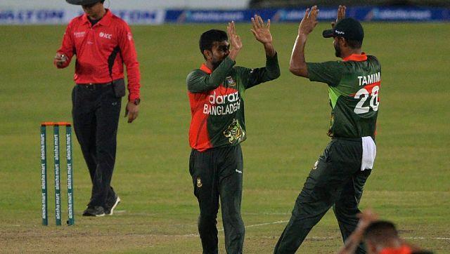 Bangladesh's Mehidy Hasan Miraz (C) celebrates with captain Tamim Iqbal after taking the wicket of Sri Lanka's Ashen Bandara. AFP