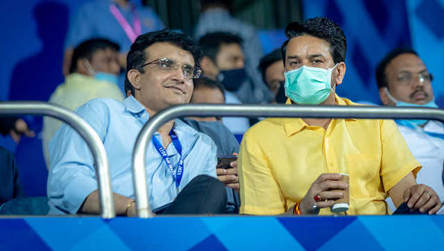 Sourav Ganguly, BCCI President (without mask) and Anurag Thakur (with mask) enjoying an IPL game, Sportzpics
