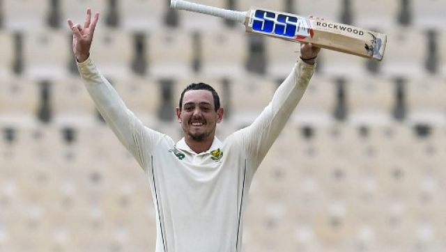 Quinton de Kock celebrates his century during Day 2 of the first Test against West Indies at the Darren Sammy Cricket Ground, Gros Islet, Saint Lucia. AFP
