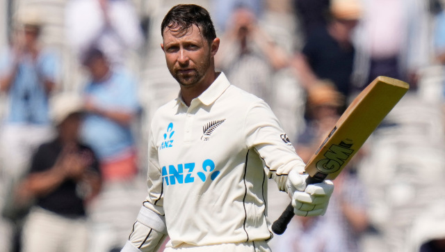 New Zealand opener Devon Conway raises his bat after bringing up his double hundred on Test debut. AP