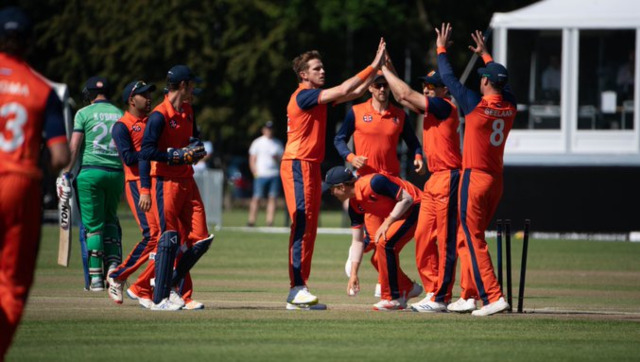 Netherlands left-arm seamer Fredrick Klaasen celebrates the fall of a wicket with teammates during the third ODI against Ireland. Image credit: Twitter/@ICC
