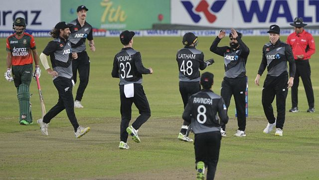 New Zealand's Ajaz Patel (third from right) celebrates with teammates after the dismissal of Bangladesh's wicket-keeper Mushfiqur Rahim. AFP