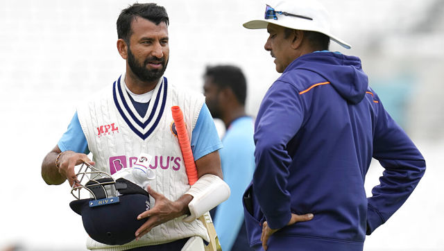 Cheteshwar Pujara speaks with Ravi Shastri during a training session ahead of the fourth Test at The Oval. AP