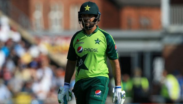 Pakistan's Sohaib Maqsood walks back to the pavilion after getting out during the second T20 international cricket match between England and Pakistan at Headingley Cricket Ground in Leeds, northern England, on July 18, 2021. (Photo by Lindsey Parnaby / AFP) / RESTRICTED TO EDITORIAL USE. NO ASSOCIATION WITH DIRECT COMPETITOR OF SPONSOR, PARTNER, OR SUPPLIER OF THE ECB