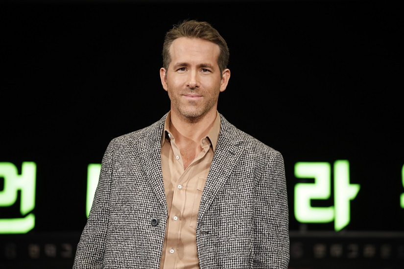 Ryan Reynolds Michael Bay talk about 6 Underground the pros and cons of releasing a film directly on Netflix